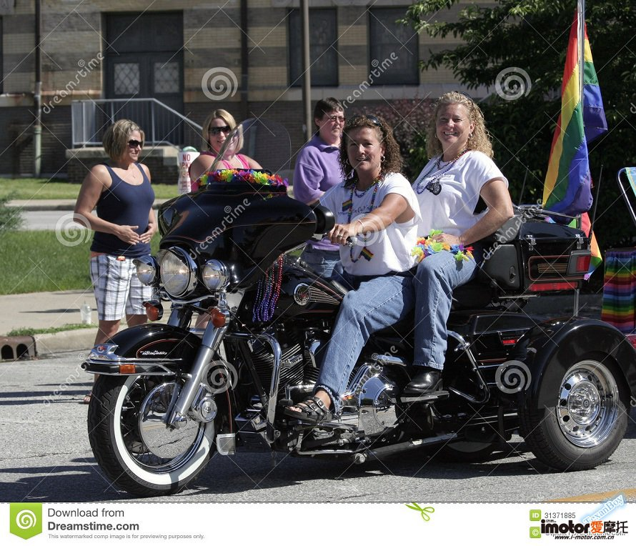 female-motorcycle-riders-rainbow-flag-indy-pride-parade-indianapolis-indiana-31371885.jpg